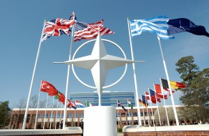 nato-symbol-with-flags-of-member-countries